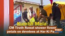 Kumbh Mela: CM Tirath Rawat shower flower petals on devotees at Har Ki Pauri