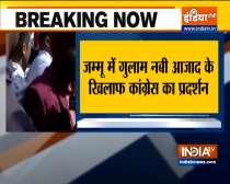 Congress workers raise slogans against Ghulam Nabi Azad and burn his effigy in Jammu