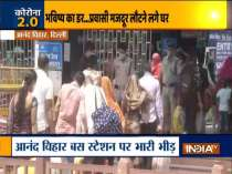 Migrant workers crowd Anand Vihar bus terminus to return to their hometown