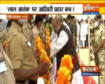 Amit Shah attends wreath-laying ceremony of security personnel martyred in the Naxal attack, in Jagdalpur