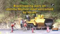 Blacktopping work on Jammu Mansar road welcomed by locals