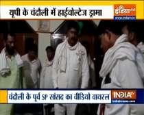 Former Samajwadi Party MP Ram Kishan Yadav touches feet of Zila Panchayat members