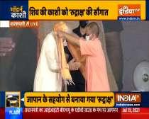 CM Yogi Adityanath felicitates PM Modi at Banaras Hindu University ground in Varanasi