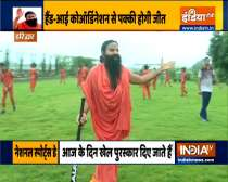 Learn yogasans for flexibility and concentration from Swami Ramdev