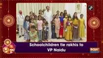 Schoolchildren tie rakhis to VP Naidu