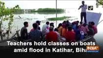 Teachers hold classes on boats amid flood in Bihar