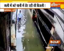 Watch: Man gets electric shock while walking on waterlogged street in UP