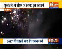 Gujarat CM recieves a grand welcome with fireworks in Gandhinagar, thousands of supporters gather to celebrate.