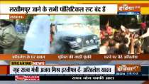 Samajwadi Party president Akhilesh Yadav stage a sit-in protest outside his residence