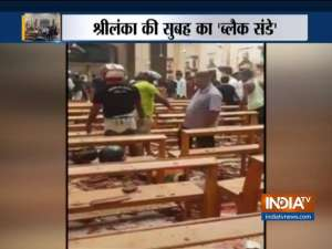 Easter blasts in Sri Lanka kill at least 215, 13 suspects held