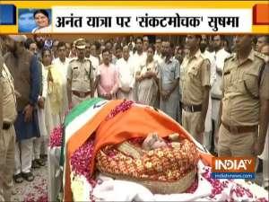Sushma Swaraj wrapped in tricolour at BJP headquarters in Delhi