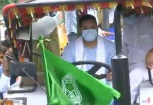 Bharat Bandh: RJD leader Tejashwi Yadav drives a tractor in Patna against farm Bills