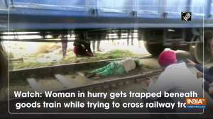 Watch: Woman in hurry gets trapped beneath goods train while trying to cross railway track