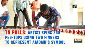TN Polls: Artist spins 234 peg-tops using two fingers to represent AIADMK's symbol