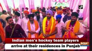 Indian men's hockey team players arrive at their residences in Punjab