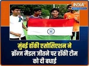 Mumbai Hockey Association players celebrate India's first Olympic hockey medal in 41 years