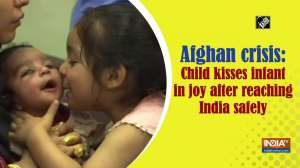 Afghan crisis: Child kisses infant in joy after reaching India safely