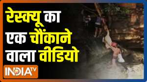 Dramatic visuals of a mother her child rescued after they trapped at the Anaivari waterfalls
